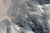 Cratered Features in Olympus Mons Aureole