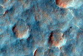 Polyphase Exit Breach in Small Crater on East Rim of Holden Crater