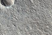 Boundary Between Acheron Fossae Upland and Adjacent Plains