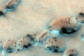 Survey of Dune-Ice Interactions Near Olympia Undae
