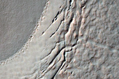 Crater Filled with Lobate Mantling Deposits and Ridges