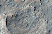 Pitted Material in Crater East of Mojave Crater