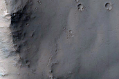 Material in Crater on South Rim of Ius Chasma