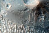 Light-Toned Deposits along Ius Chasma Wallrock