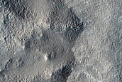 Layered Mesa in Crater South of Semeykin Crater