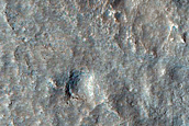 Dipping Layers in Crater Near Mamers Valles
