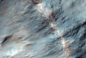 Spectrally Distinct Crater Ejecta in Tyrrhena Terra