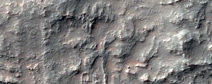 Possible Exposed Layered Ejecta North of Kontum Crater