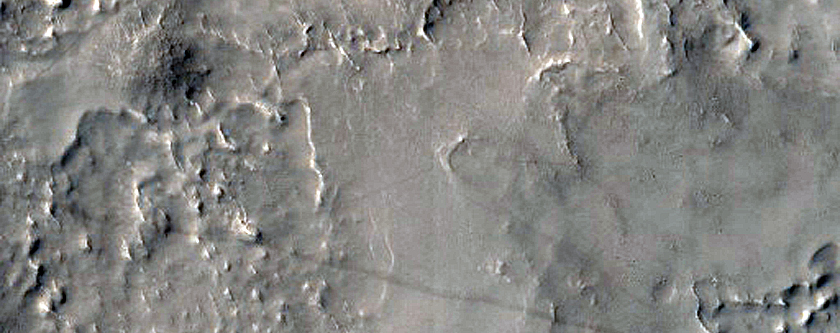 Sinuous Inverted Channel in Large Basin in East Arabia Terra