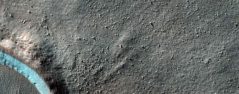Layered Arcuate Ridges at Base of Gullies