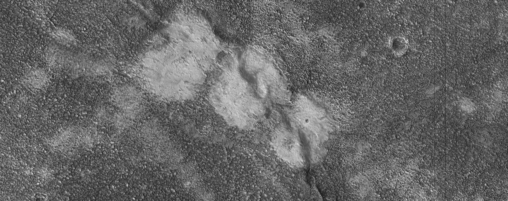 Mounds Cut by a Fissure