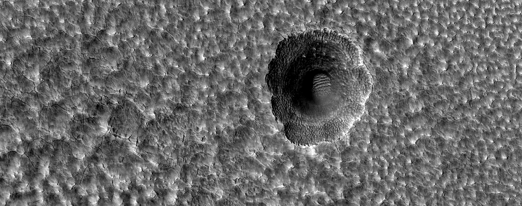A Crater Enlarged by the Sublimation of Ice