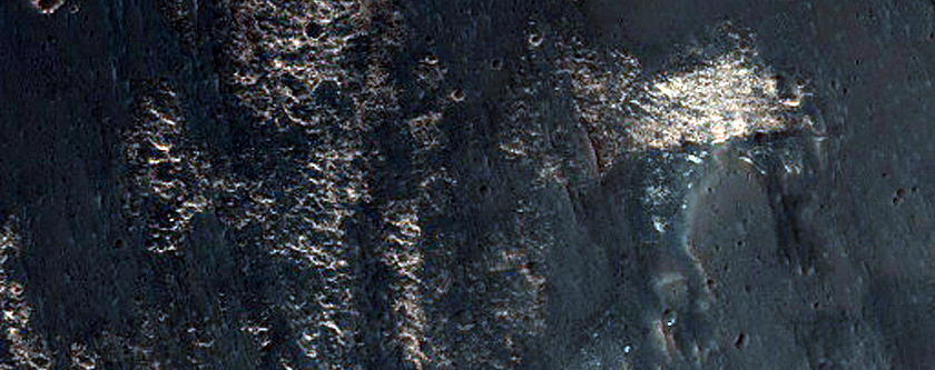 Light-Toned Material in Lower West Candor Chasma Wall