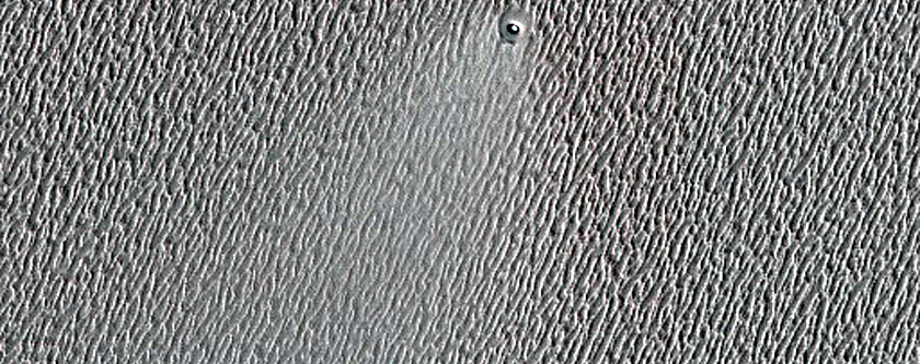 Small North Polar Layered Deposits Ice-Filled Crater