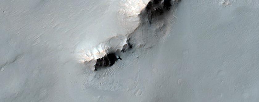 Portion of Well-Preserved Peak of 41-Kilometer Crater in Terra Sabaea