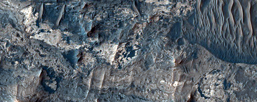 Hydrated Minerals in Ius Chasma