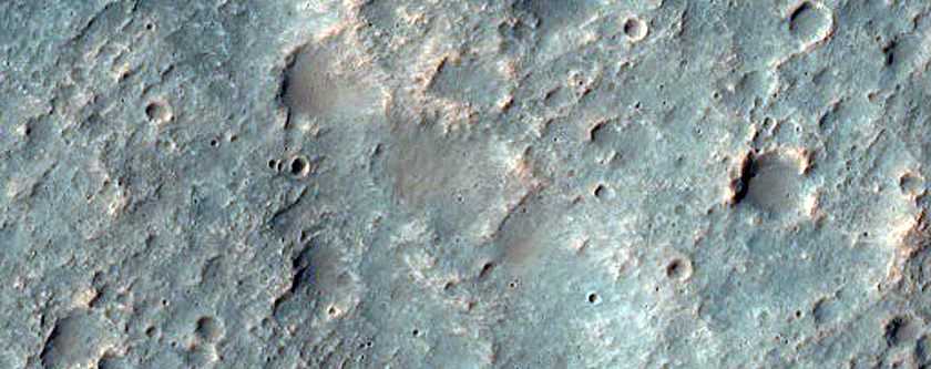 Incised Channel with Light-Toned Deposits in Intercrater Plain