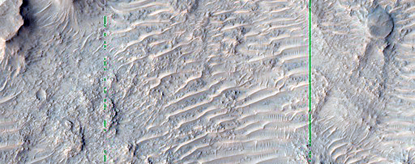 Colorful Exposures on Rim of 12-Kilometer Crater North of Hellas Planitia