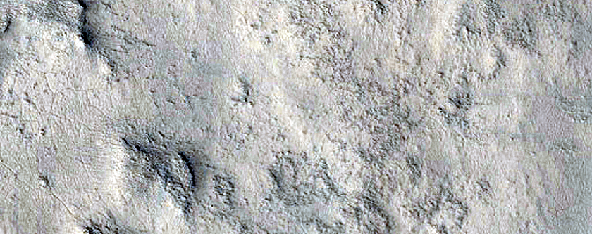 Fan-Shaped Feature with Sinuous Ridges near Rim of Antoniadi Crater