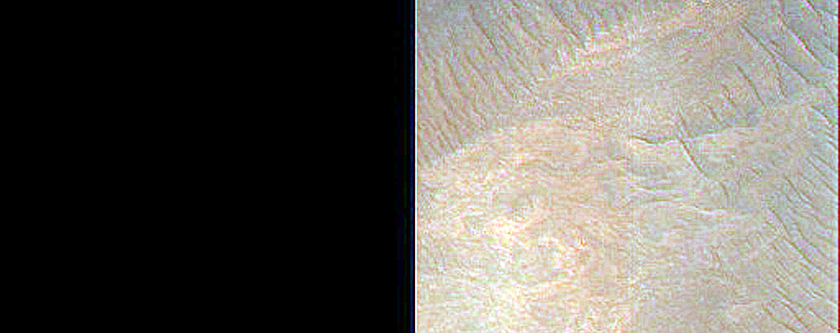 Light-Toned Layered Material in Depression in West Juventae Chasma