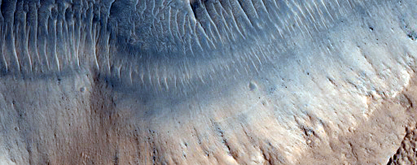 Layered Features in Depressions near Reull Vallis