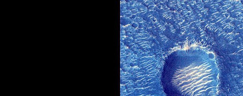 Interesting Deposit of Dark Material in West Arabia Terra