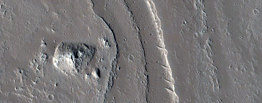 Conical Feature near Channels and Fissures in Tharsis Region