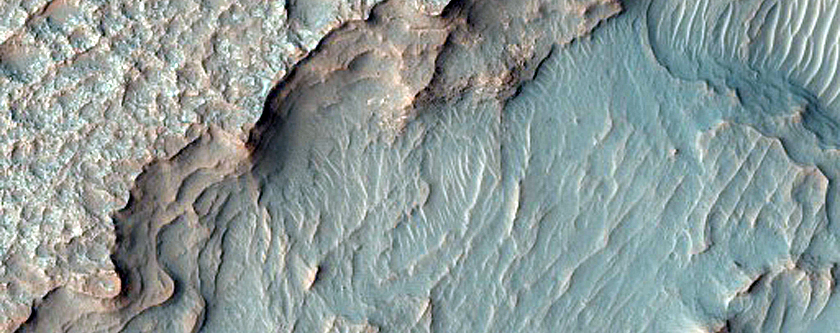 Flat Layered Deposits and Candidate Exit Breach in Small Young Crater