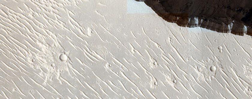 Cerberus Fossae Slopes with Boulder Tracks