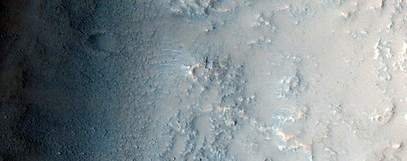 Western Flank of Crater Overtopped by Flows