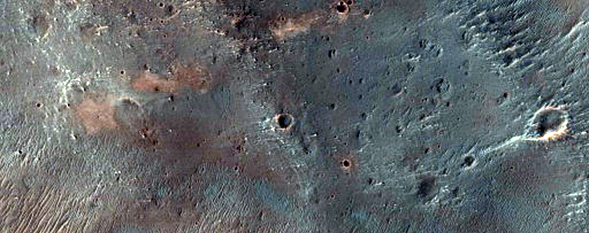 Craters Exposing Diverse Compositions Southeast of Herschel Crater
