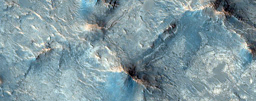 Phyllosilicate-Rich Central Pit and Landslide in Tyrrhena Terra