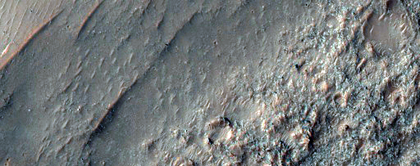Crater Ejecta Lobe Surrounded by Mesa-Forming Material