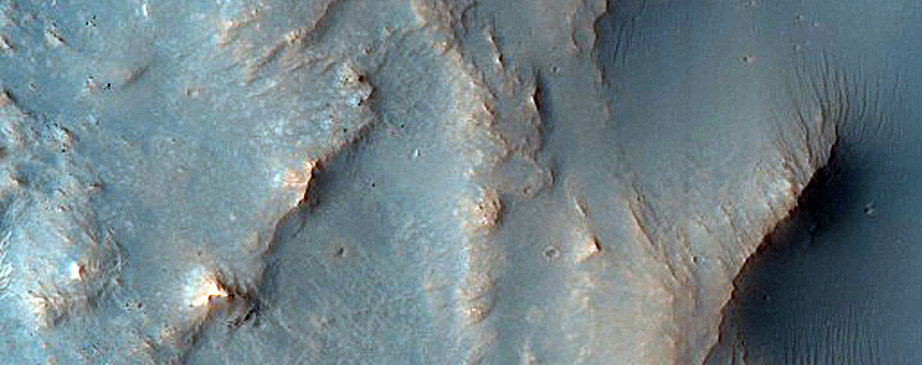Flows and Pitted Material in Terra Sirenum