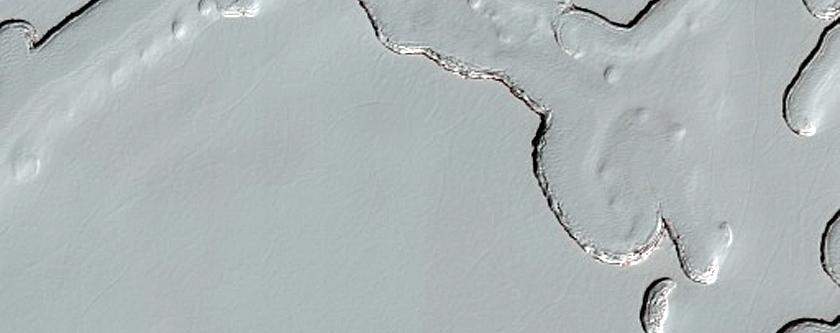 South Polar Residual Cap Mesas and Swiss Cheese Terrain