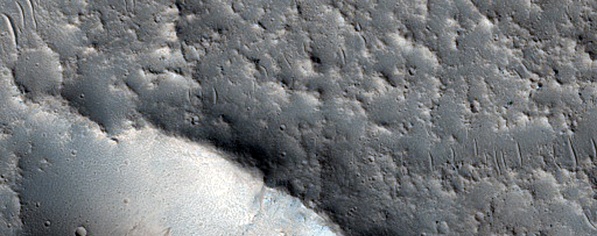 Oblique Impact which Resembles Volcanic Collapse Features