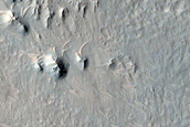 External Ponded and Pitted Materials off Western Rim of Mojave Crater