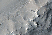 Ridges and Crescentic Forms in Arabia Terra