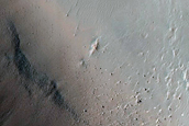 Crater Exposing Layers Filling Larger Crater