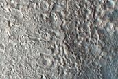Crater Hanging on Mesa Wall in Deuteronilus Mensae