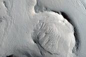 Layered Deposits in Crater in Arabia Region