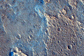 Fan-Shaped Deposit with Floor Outcrop in Camichel Crater