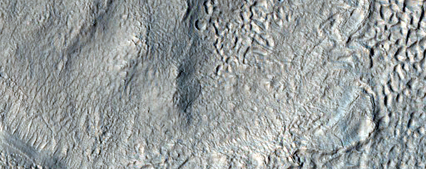 Sinuous Ridge and Channel Through Ice Rich Terrain