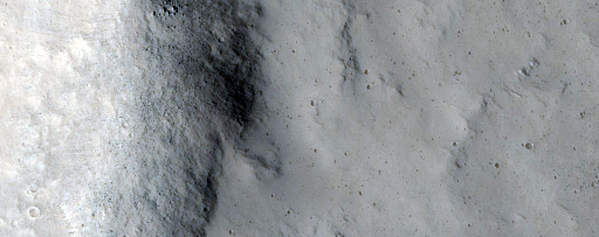 Pasted-on Material on Crater Ejecta