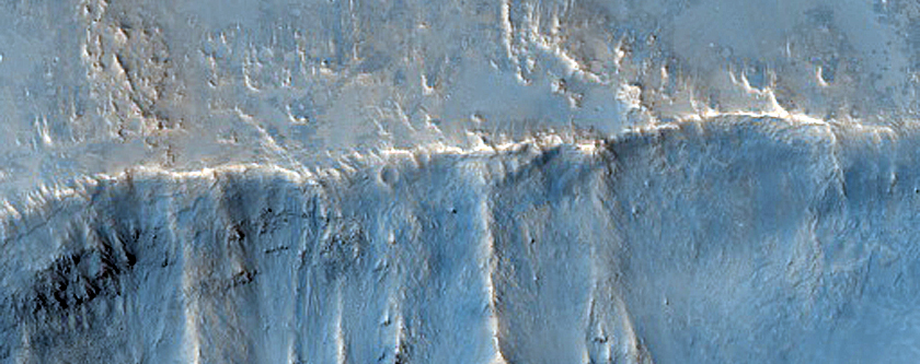 Crater Uplift and Ejecta in Tyrrhena Terra