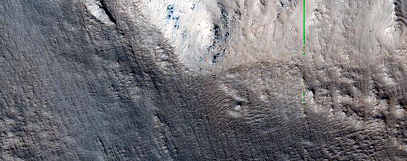 Crater Rim and Floor near Tantalus Fossae