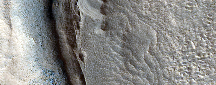 Dipping Layers in Crater in Deuteronilus Mensae