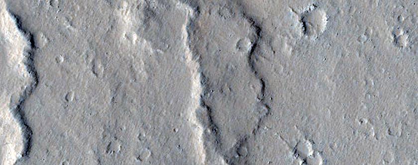 Mare-Type or Wrinkle Ridge Cutting across Diverse Landforms