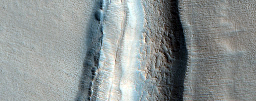 Dipping Layers Outside Large Crater Rim in Northern Mid-Latitudes