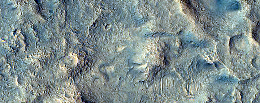Eroded Layered Deposits on Floor of Orson Welles Crater